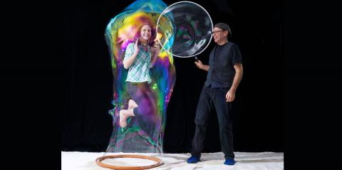 The Amazing Bubbleman - Louis Pearl putting an audience member inside a bubble