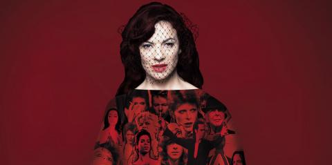 Camille O'Sullivan, dark hair and face veiled, against a dark red background, in a dress with David Bowie's faces on it