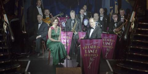 Piccadilly Dance Orchestra: a large group of people dressed in fancy suits and dresses, all looking at the camera smiling
