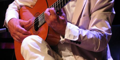 Juan Martin's hands on his guitar