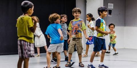 a group of children playing in a drama studio