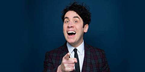 """Pete Firman smiling and pointing at the camera in a """"Got You!"""" gesture"""