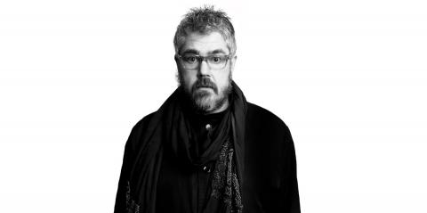 a black and white image of Phill Jupitus looking gloomy