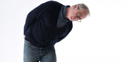 Robin Ince bending down and looking inquisitive