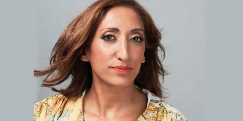 Shazia Mirza against a grey background