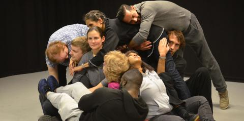 a group of people piled on each other