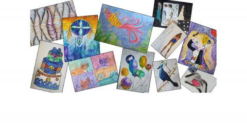 A photo of colourful drawings made by children.