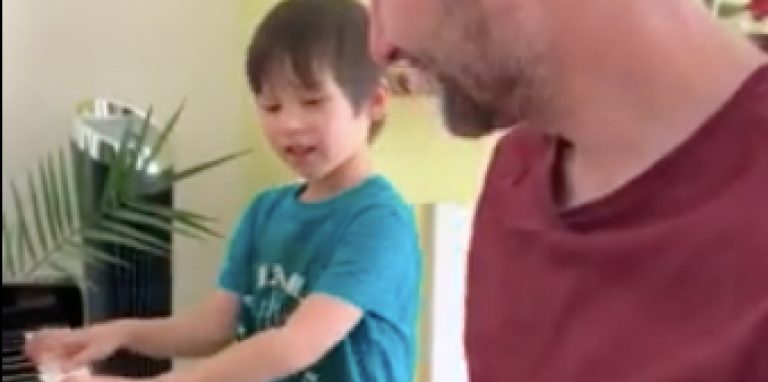 son and dad on piano