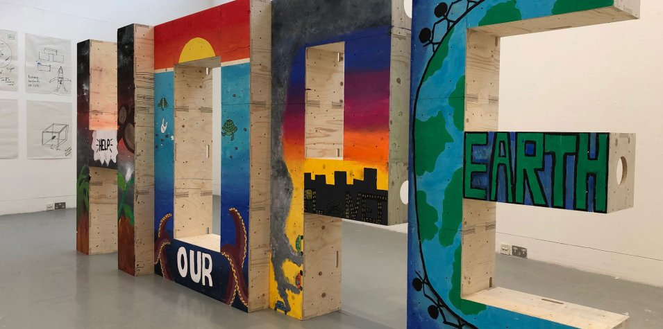 Climate Emergency exhibition: the word Hope is spelled in big letters made of painted wooden blocks made by students
