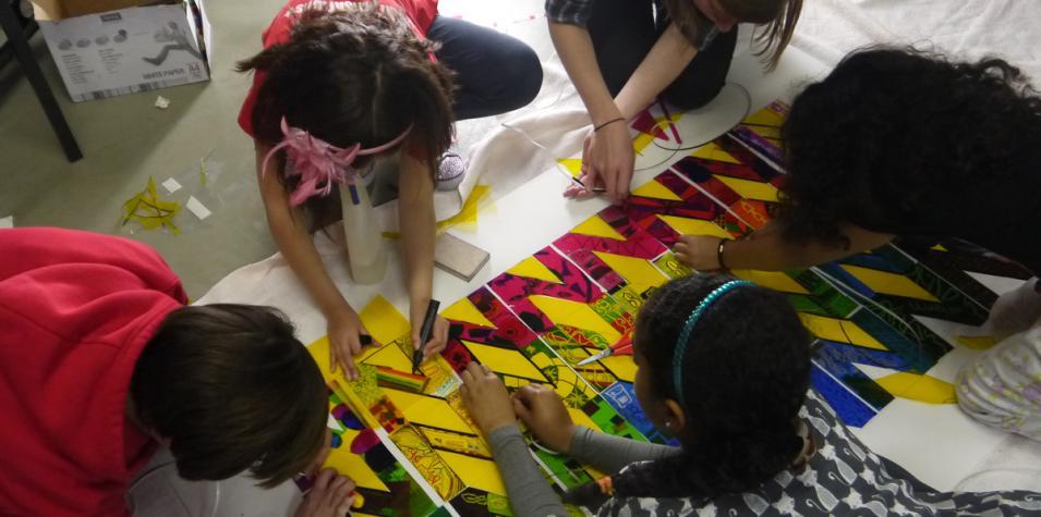 Image of members of Noah's Ark Siblings Group creating artwork