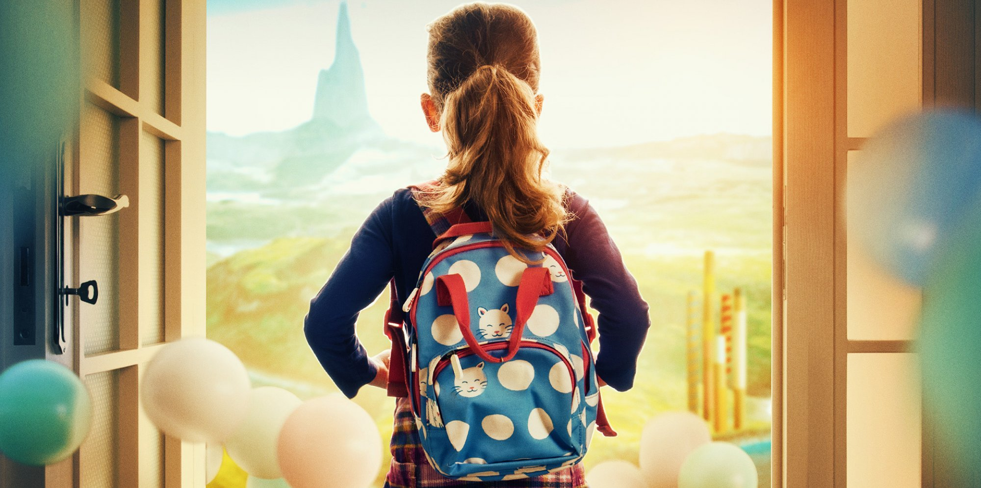 A child wearing a backpack looks out of an open door to a vast landscape