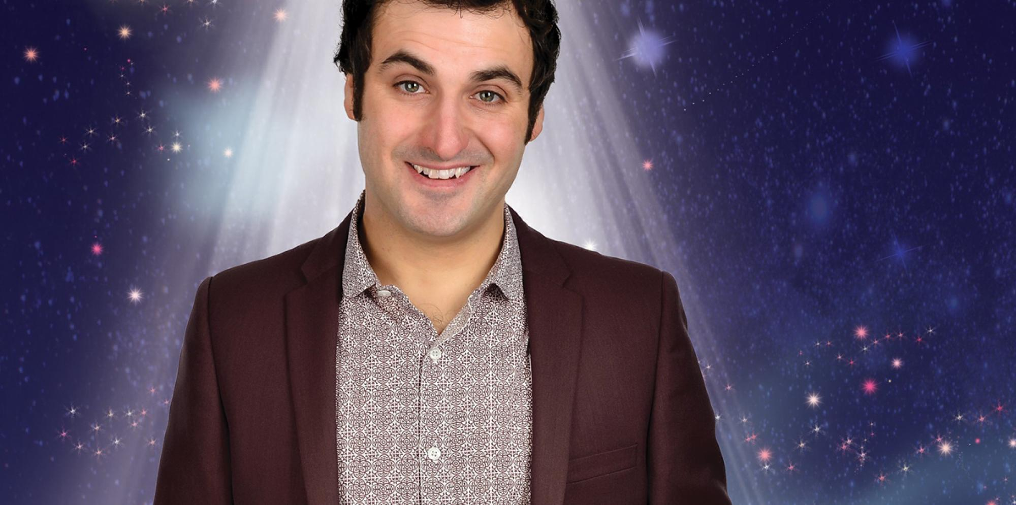 Pub Quiz for Kids: Patrick Monahan smiling in a spotlight