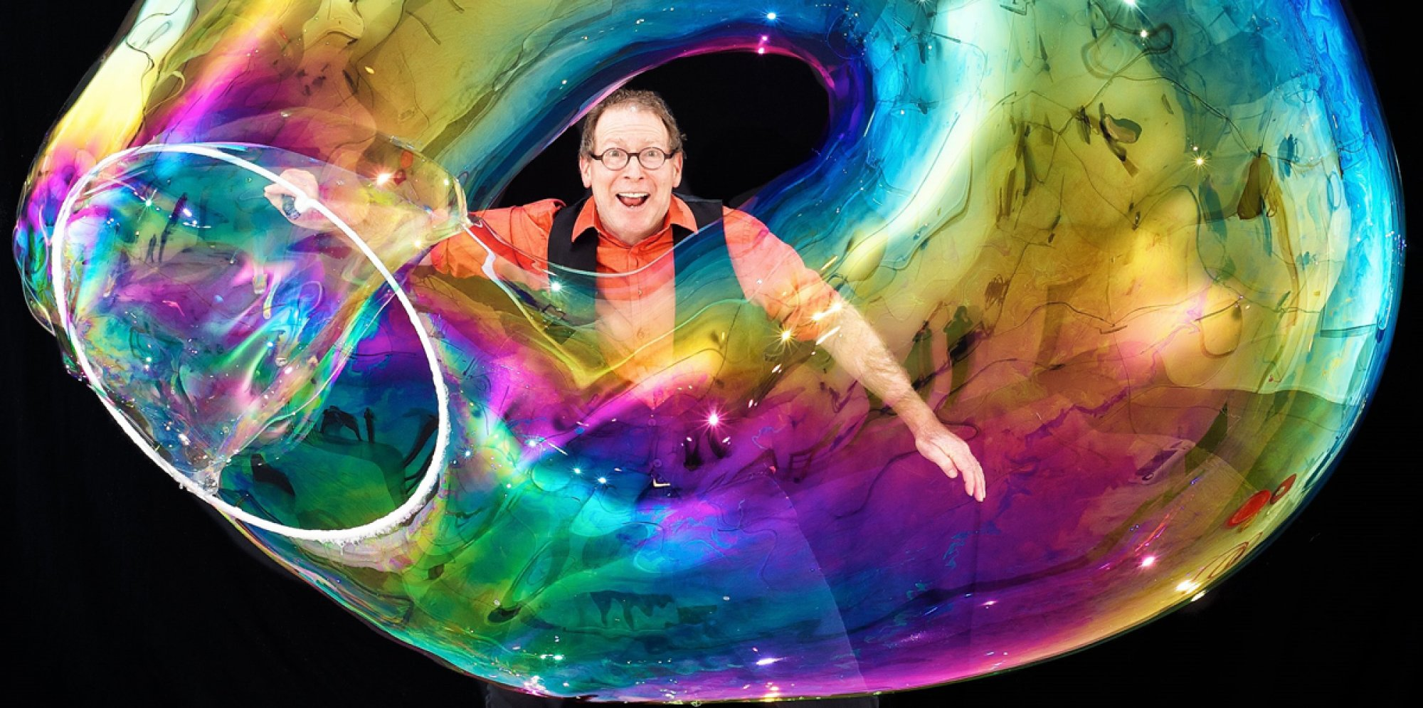 Louis Pearl in a rainbow-coloured bubble ring