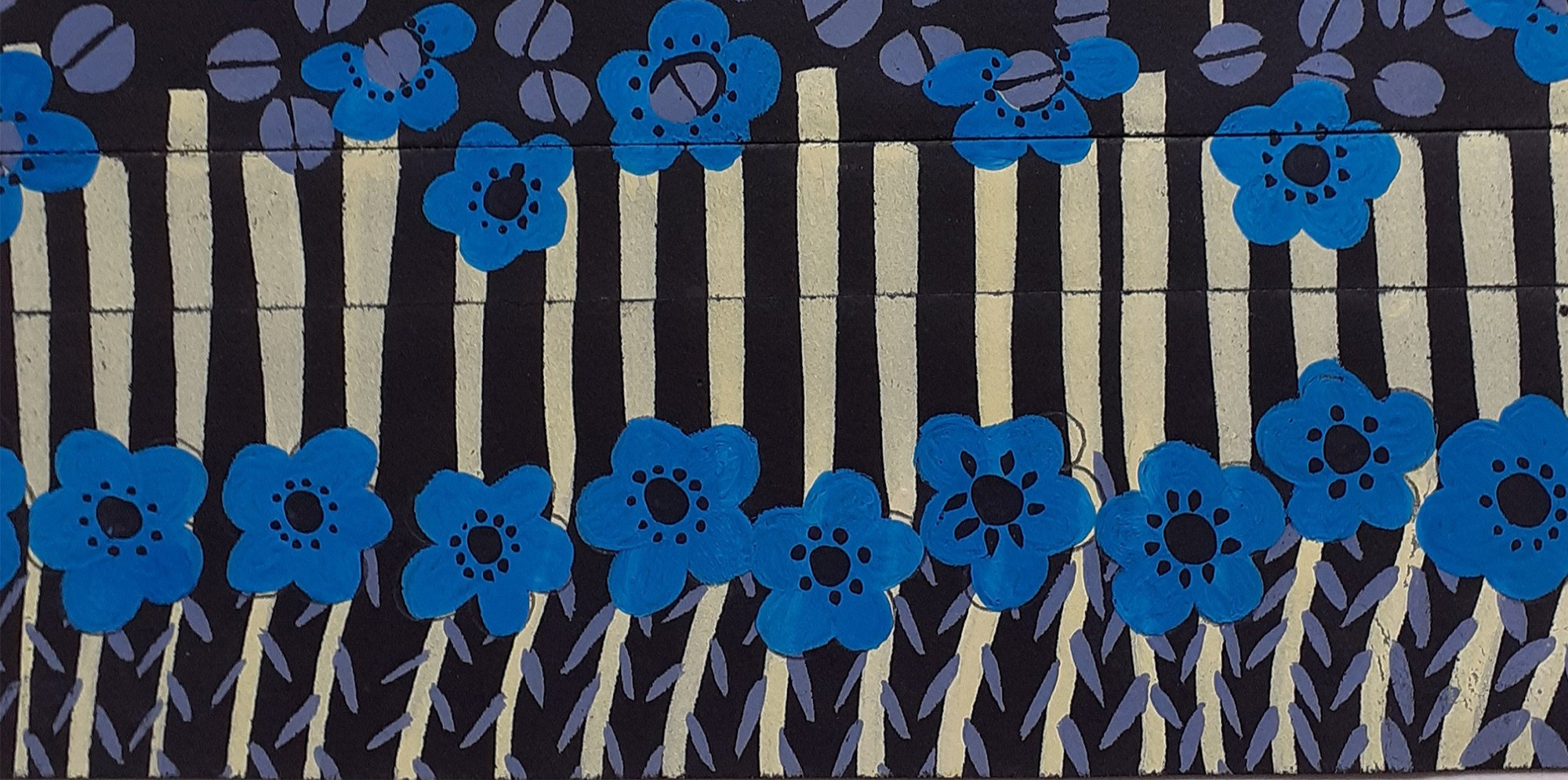 A pattern made up of blue and white flowers and white lines against a black background