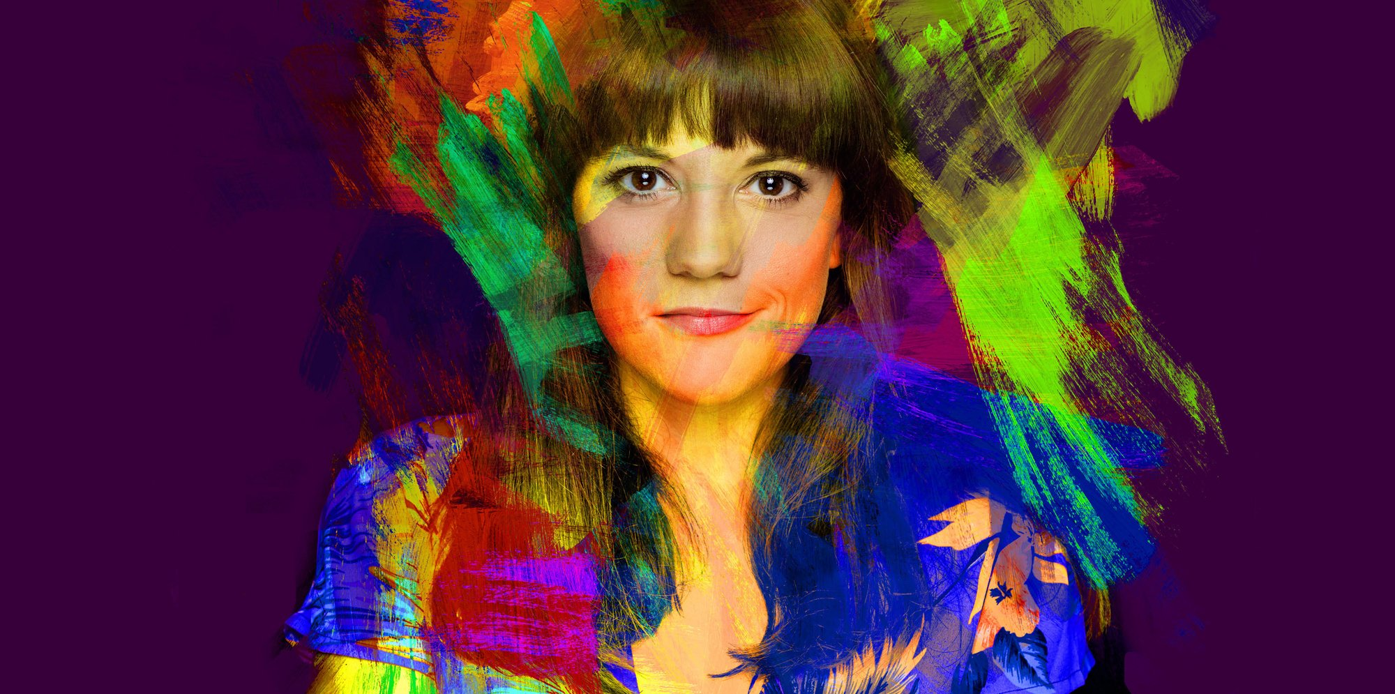 Vikki Stone looking into the camera, her image covered in broad strokes of colourful paint