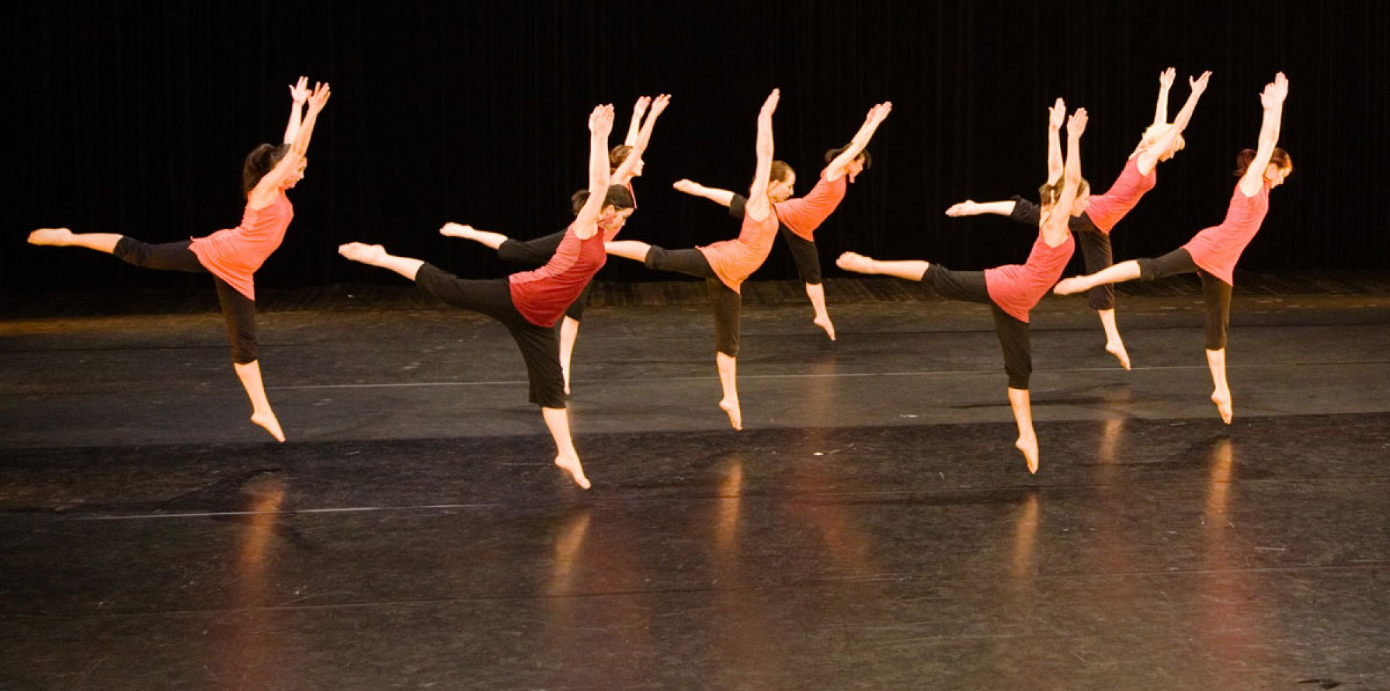 A group of young dancers performing on stage