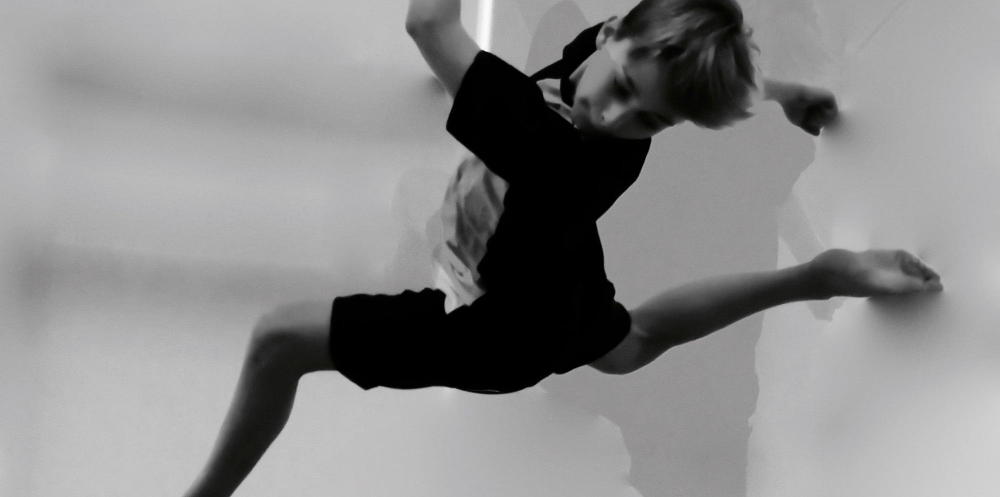cool picture of a boy in black and white doing a flip