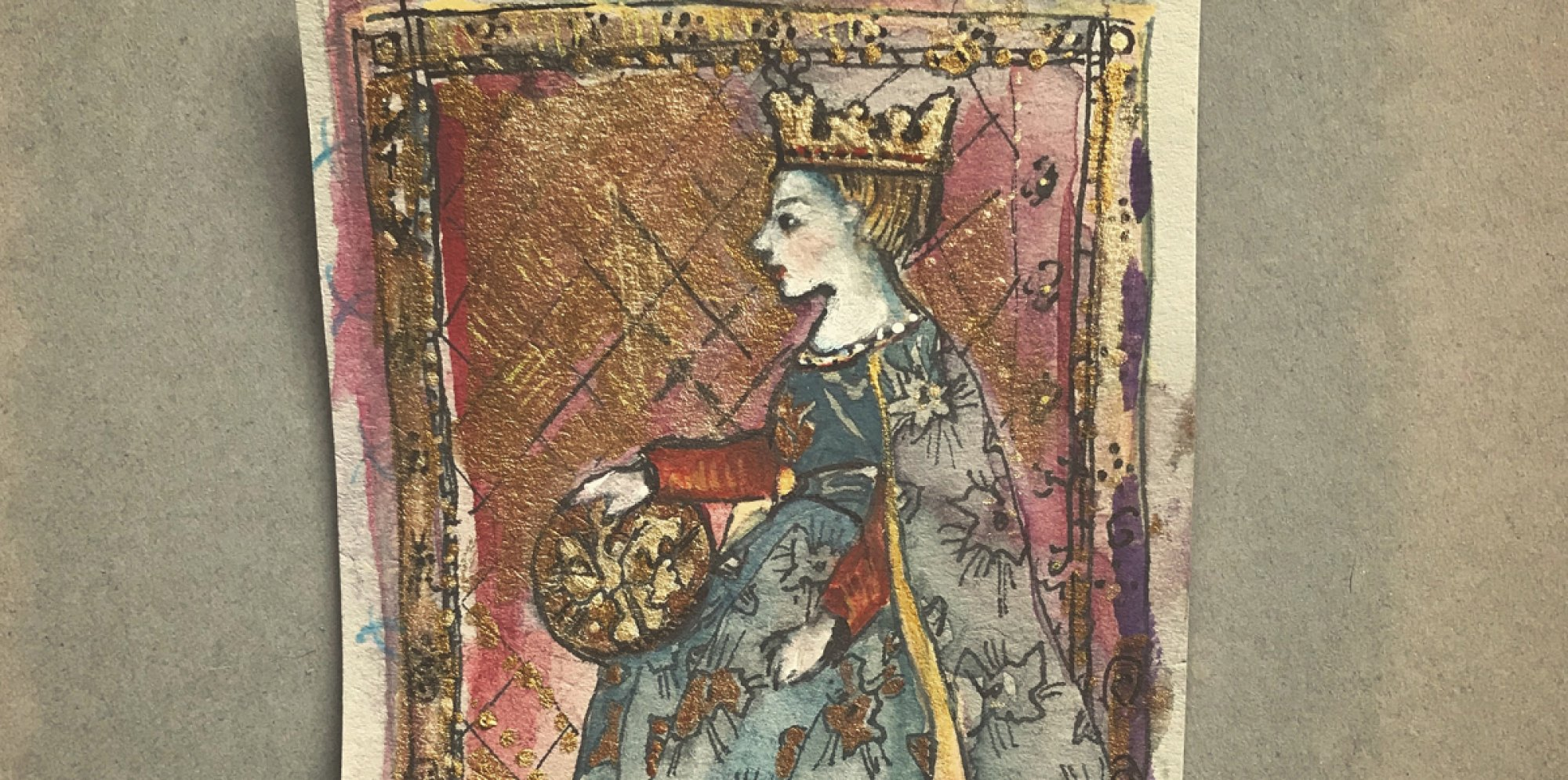 a yellowed paper card with a handpainted image of a queen sitting in profile. She wears a crown and an elaborate embroidered dress. A golden frame and panes embellish the image around her.