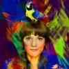 Vikki Stone looking into the camera, her image covered in broad strokes of colourful paint. On her head sits a yellow parrot.