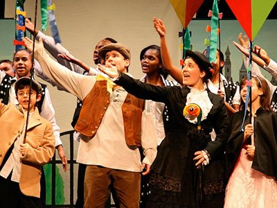 Anna Fiorentini: The cast of Mary Poppins, children dressed in 19th century clothing, singing with their arms raised to hold kites