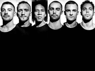 six men in black and white