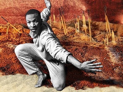 A black and white image of a dancer in front of a coloured background of a war torn landscape: red earth, burnt matchsticks and explosions