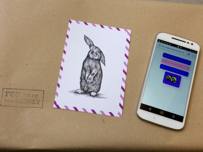 an image of an envelope with a picture of a rabbit and a note next to it