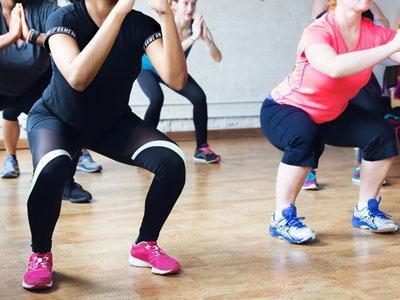 a group of women doing squats