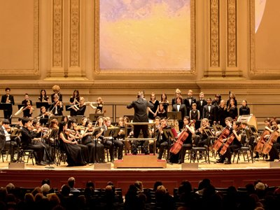 Dwight School London: an orchestra of young people on an opulent concert hall stage