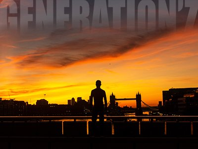 The shadowy outline of a man standing on a bridge looking into a bright red sunset. The words Generation Z is outlined against the sky