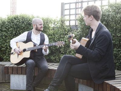 Joe and Andrea performing outside