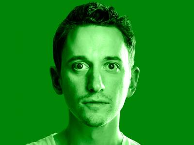 John Robins: A man in his thirties looking straight into the camera. He is white, has short hair and his eyes are wide open.