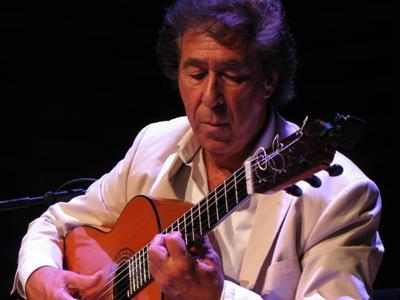 Juan Martin playing his guitar