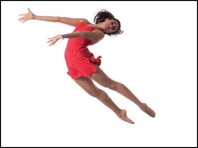 LSC Spring Showcase - A Woman in Red Leaps into the Air