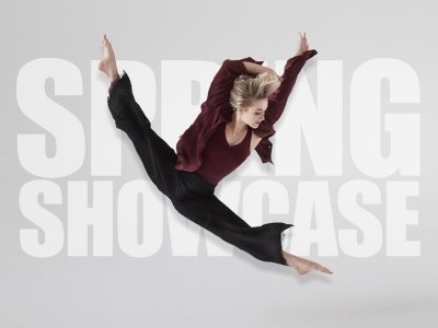 a female dancer does the splits mid air on a white background