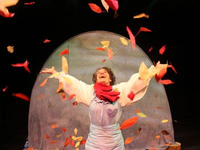 Leaf - The actor throws Autumn leaves over their with apparent joy