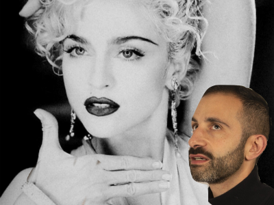 a man looking at a picture of madonna