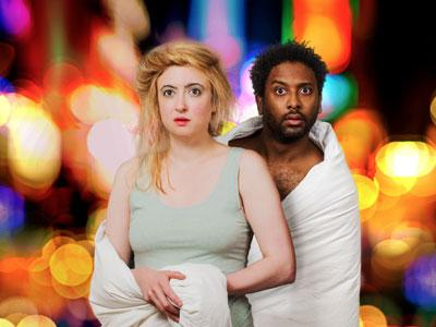OperaUpClose: The Magic Flute (two performers in bed clothes stare dazed at camera)