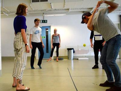 A photo of Manic Chord Theatre playing an indoor ball game during an R&D residency.