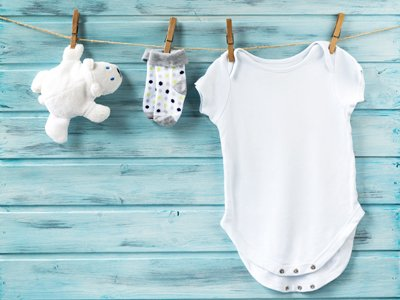Mighty Mini Productions: a white teddy bear, socks and a baby grow hanging from a washing line