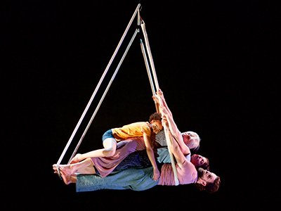 Four performers on a piece of aerial equipment. One is a teenager, one in her sixties and two are in their thirties.