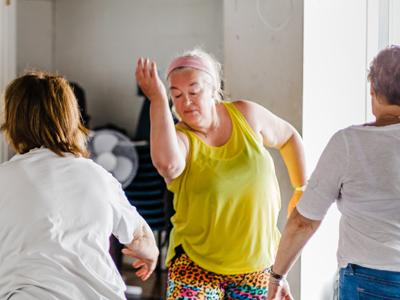 a group of women over 60 dancing gracefully