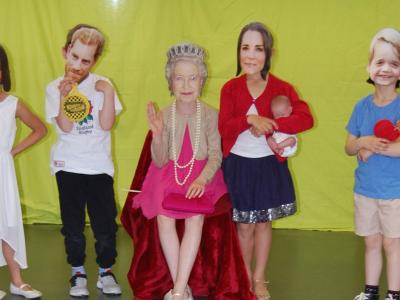 children wearing celebrity cardboard masks of the royal family