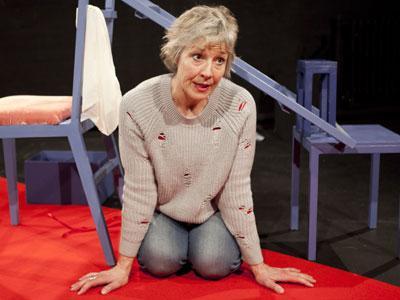 Danyah Miller kneeling on a bright red carpet