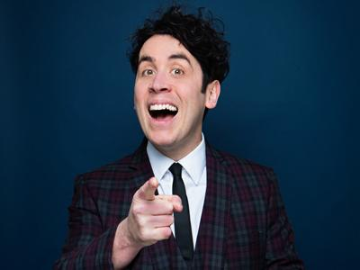 "Pete Firman smiling and pointing at the camera in a ""Got You!"" gesture"