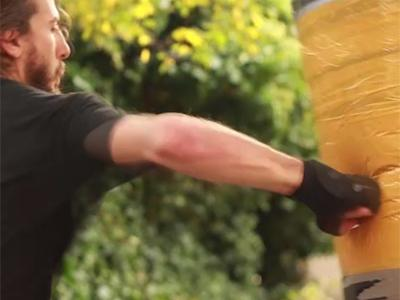Rodrigo B Camacho Problem: a man with boxing gloves punches a battered orange punching bag