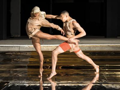 Rambert Dance Rambert2 two young dancers in nude clothing dancing in an empty space