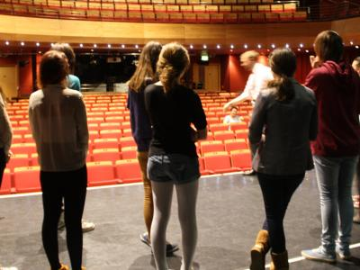 photo of a group of students looking out across the theatre