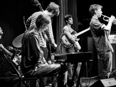 a band of young people playing jazz instruments