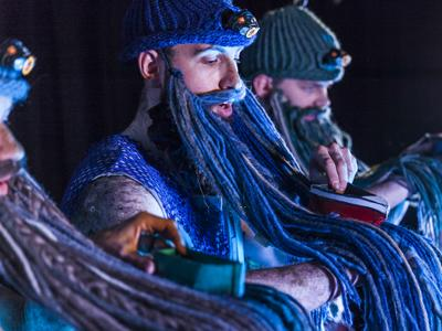 The Boy and the Mermaid: three men weave little boats through their beards